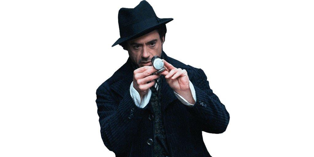 Robert Downey Jr. as Sherlock Holmes looking a compass