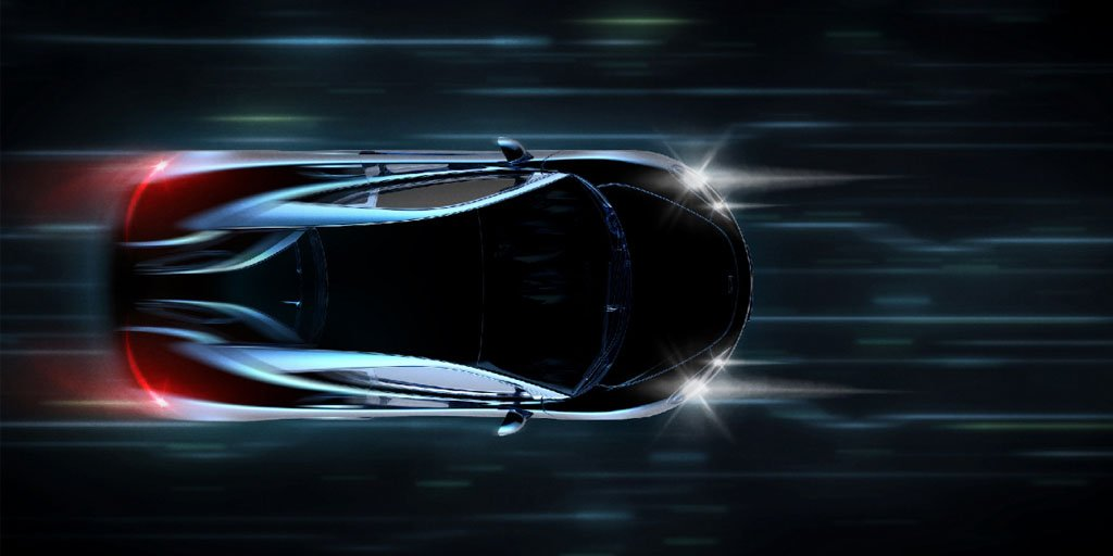 Black sports car driving fast seen from above